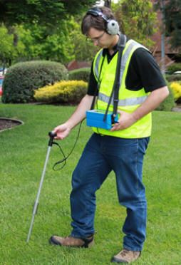Technician Performing Electronic Leak Detection